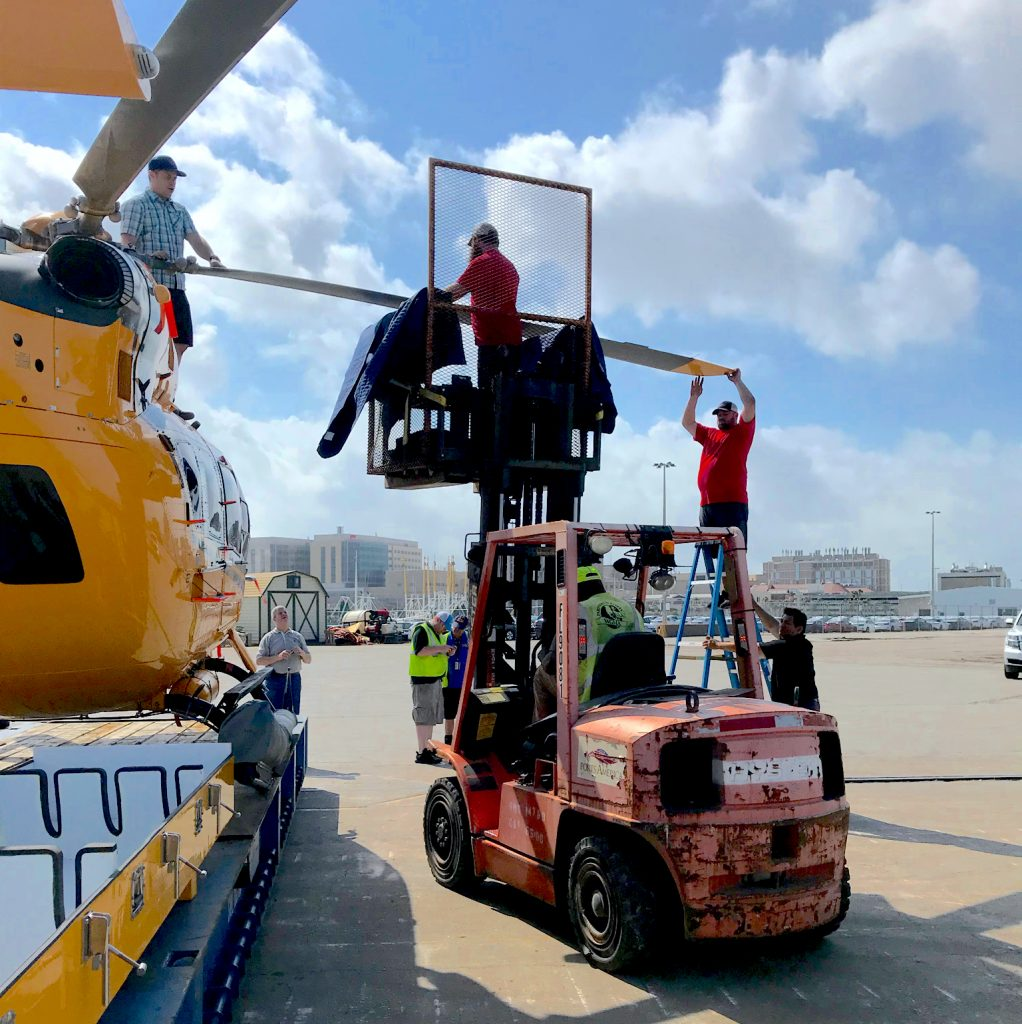 Fork Lift assisting technician in removing the blade on an H145 airbus helicopter.