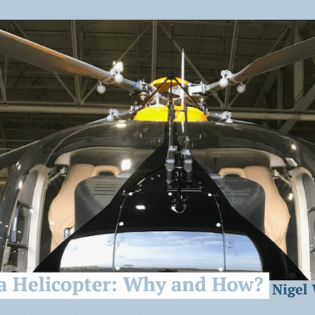 """Close up of an H145 helicopter from the front showing main rotor, with title """"weighing a helicopter: why and how?"""""""